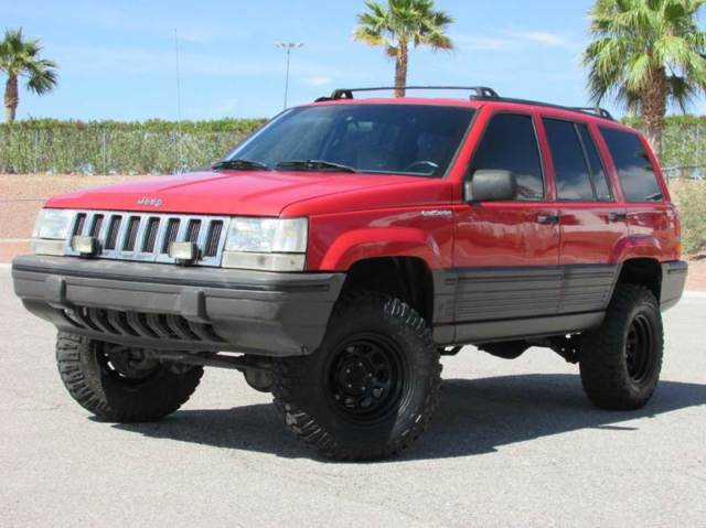 SUPER RARE 5 SPEED MANUAL 4X4 4.0L 93 JEEP GRAND CHEROKEE LIFTED RUST FREE!!