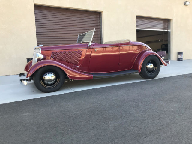 1934 Red Ford Roadster Convertible with Tan interior