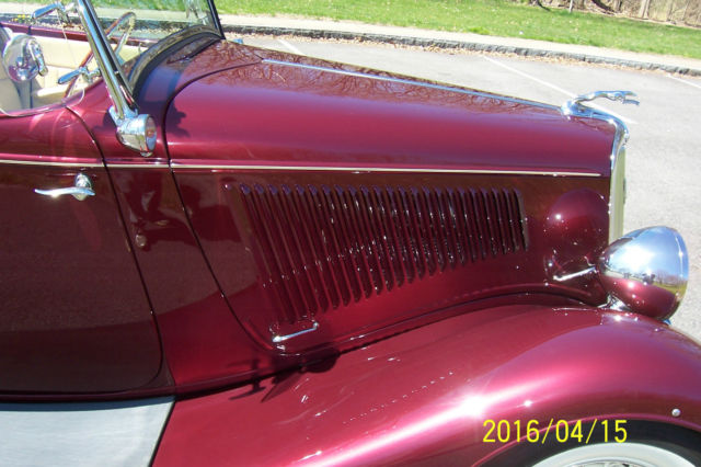 1934 Burgundy Ford Roadster Model 40 Convertible with Tan interior
