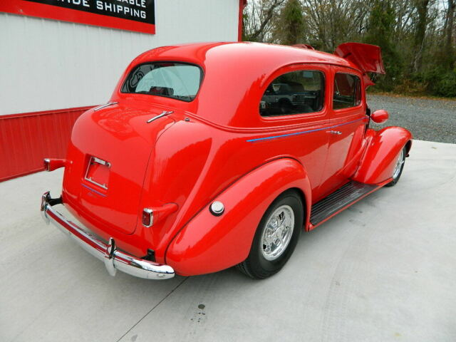 1937 Red Chevrolet Chevy Master Deluxe Coupe with Gray interior