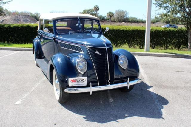 1937 Blue Ford Phaeton Convertible -- with Tan interior
