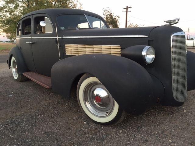1937 lasalle by cadillac motor company suicide door for Cadillac motor car company