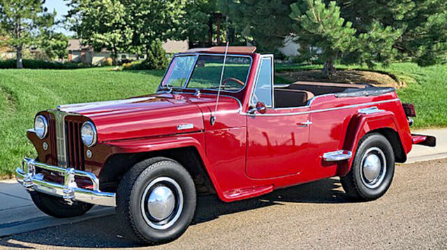 1949 Red Willys Overland Light Four Jeepster Convertible with Gold interior