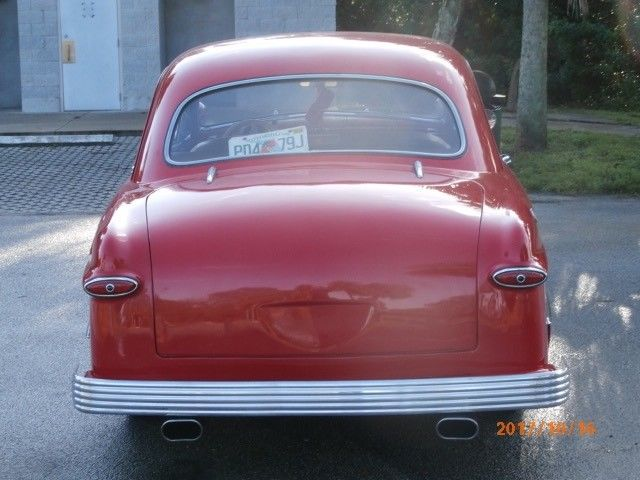 1950 Red Ford Customline Coupe with Brown interior