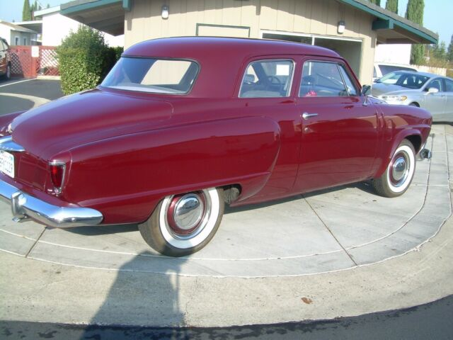 1952 maroon Studebaker Champion regal with gray interior