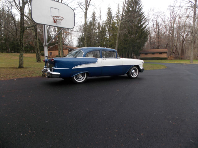 1955 Oldsmobile Super 88  2 door sedan  Dark blue and white