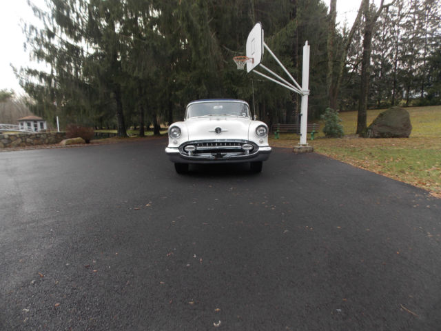 1955 Oldsmobile Super 88  2 door sedan  Dark blue and white with