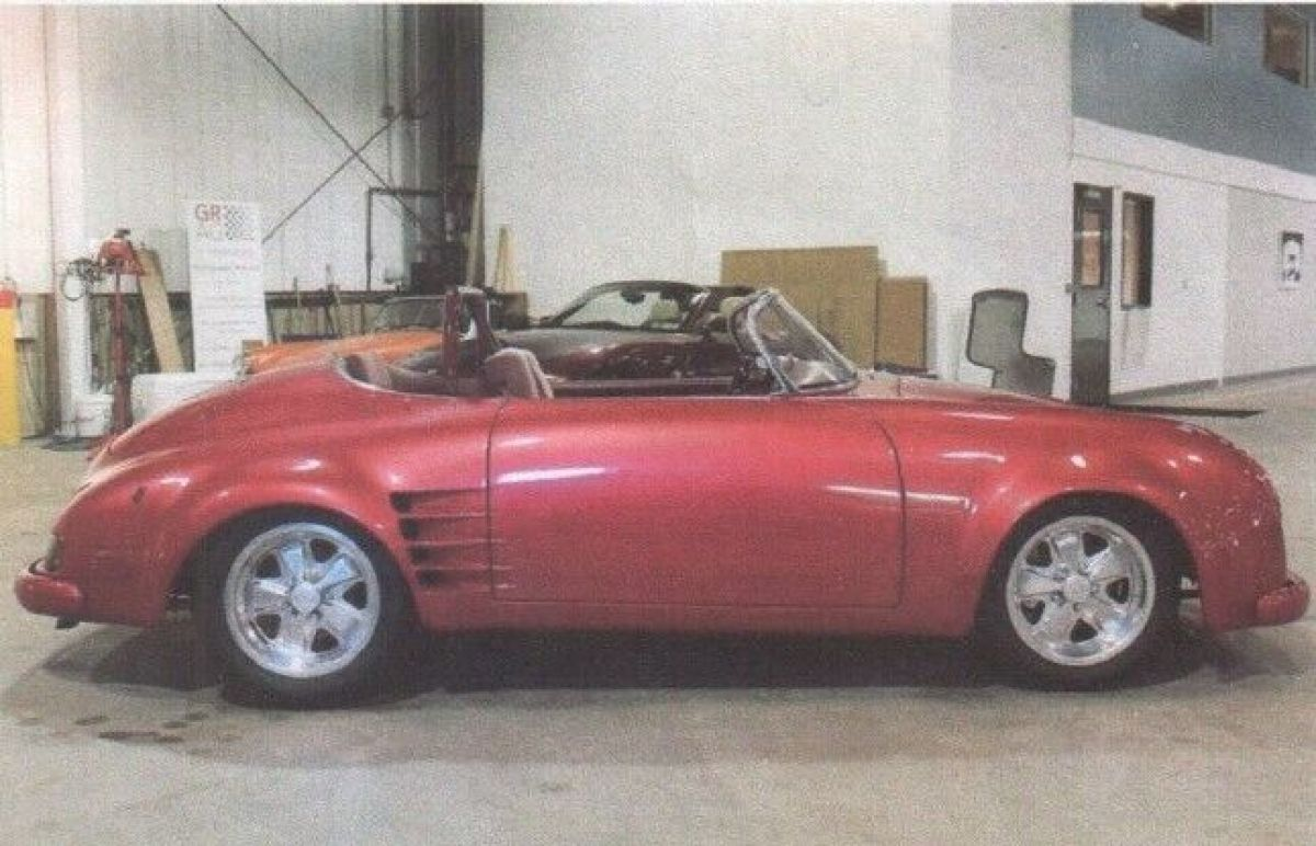 1955 Raspberry Porsche 356 Speedster Convertible with Red interior