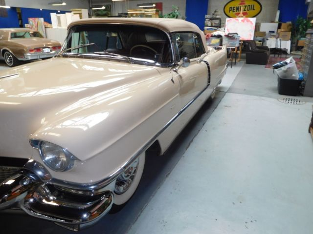 1956 pecos beige Cadillac DeVille Convertible with red leather / red carpets & red trim interior