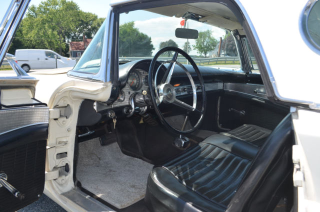 1957 White Ford Thunderbird with Black interior