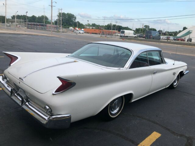 1960 White Chrysler New Yorker New Yorker Coupe with Red interior