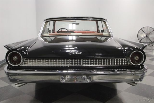 1961 Black Ford Galaxie with White interior