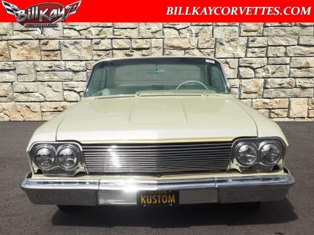 1962 Yellow Chevrolet Impala Coupe with White interior