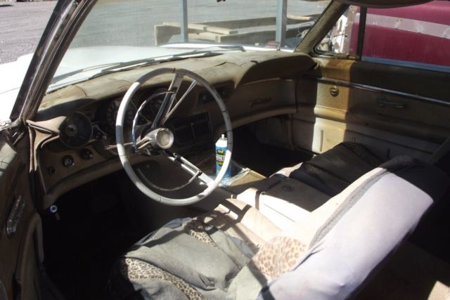 1962 blue Ford Thunderbird Coupe with white interior