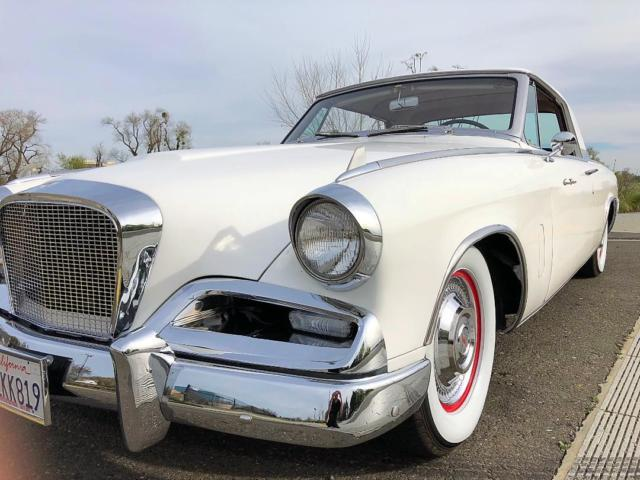 1962 White Studebaker Hawk Coupe with Red interior