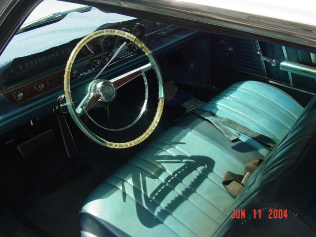 1964 White Pontiac Bonneville with Blue interior