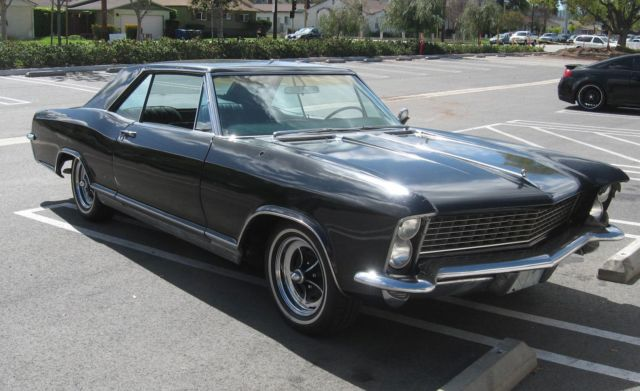 1965 Black Buick Riviera with green interior