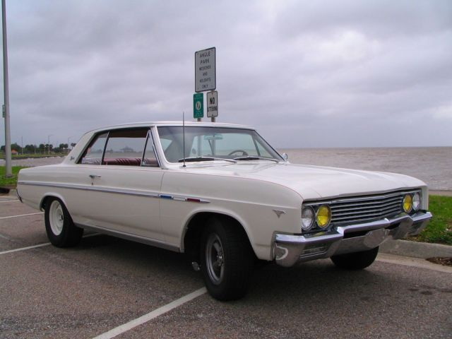 1965 White Buick Skylark Coupe with Red interior