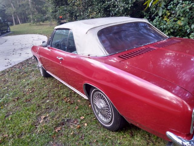1965 Red Chevrolet Corvair Convertible with White interior