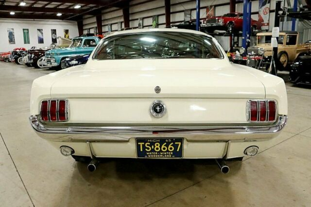 1965 Cream Ford Mustang 2+2 Coupe with Red interior