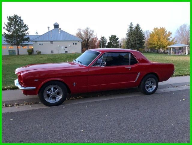 1965 Red Ford Mustang Coupe with Black interior
