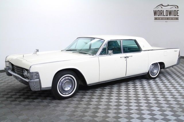 1965 lincoln continental suicide doors restored white. Black Bedroom Furniture Sets. Home Design Ideas