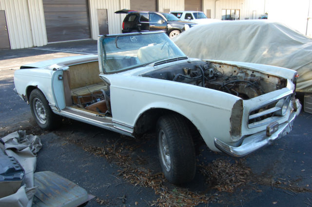 1965 mercedes benz sl class fl title rolling chassis for Mercedes benz classic car parts