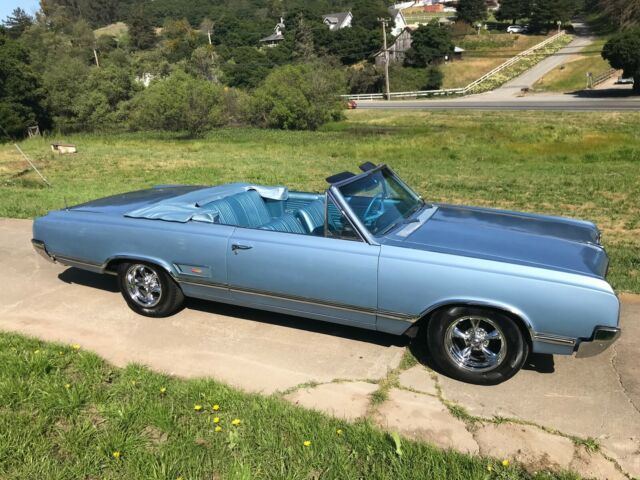 1965 Blue Oldsmobile Cutlass Convertible with Blue interior