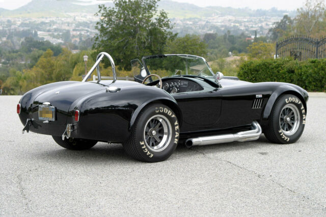 1965 Black Shelby Cobra Roadster with Black interior