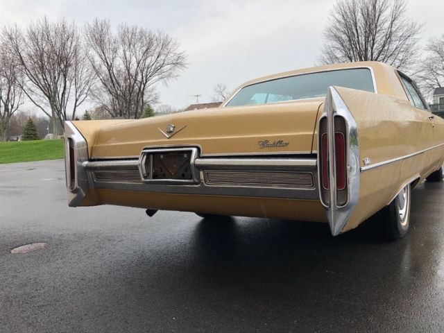 1966 Gold Cadillac DeVille Coupe with Gold interior