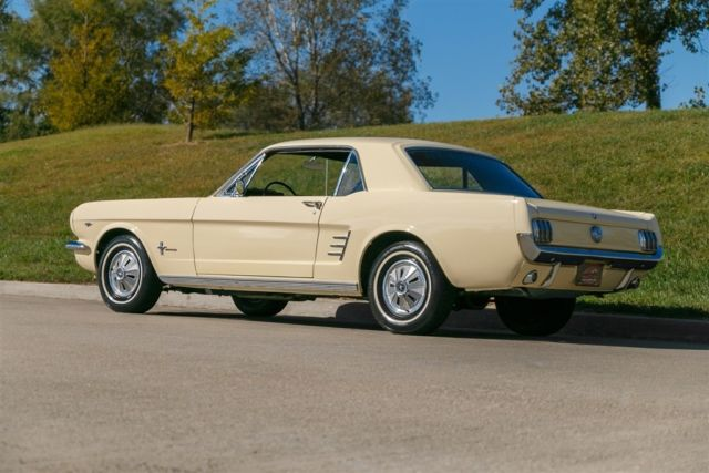 1966 Yellow Ford Mustang Coupe with Black interior