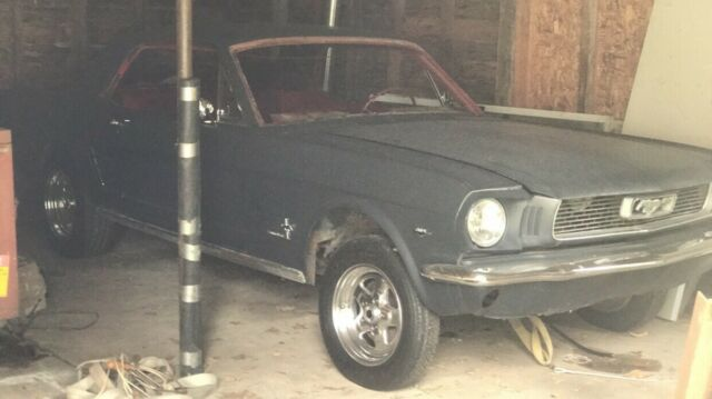1966 Black Ford Mustang Coupe with Red interior