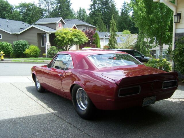 1967 Candy Apple Red Chevrolet Camaro Coupe with Black interior