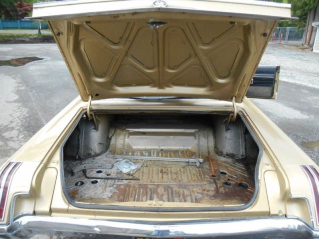 1967 Gold Chrysler 300 Series Convertible with Black interior