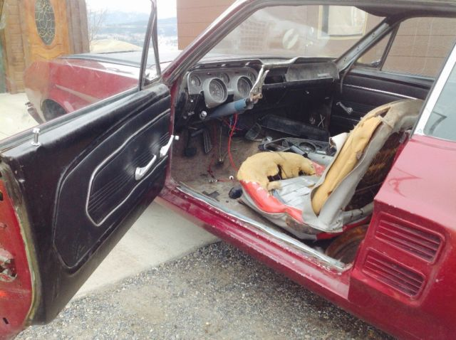 1967 Red Ford Mustang Coupe with Black interior