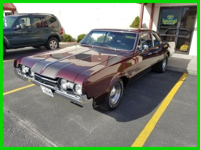 1967 Red Oldsmobile Cutlass Coupe with Black interior