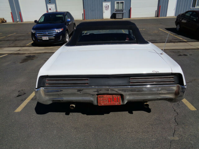 1967 White Pontiac Grand Prix Convertible with Red interior