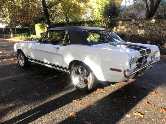 1968 White Ford Mustang Coupe with blue/white interior