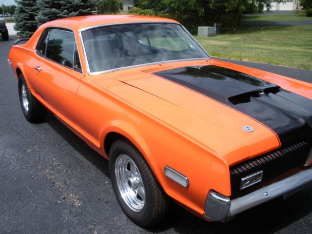 1968 Orange Mercury Cougar Coupe with Black interior