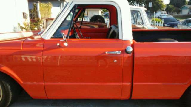 1969 orange Chevrolet C-10 shortbed fleetside with black and orange interior