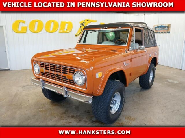1969 Orange Ford Bronco Wagon -- with Cream interior