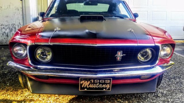 1969 Ford Mustang red with black stripes & hood