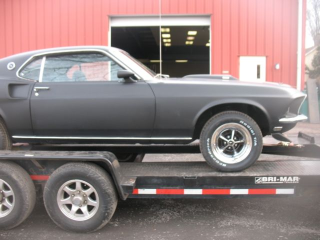 1969 Black Jade Ford Mustang Fastback with Black interior