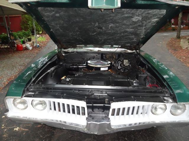 1969 Oldsmobile Cutlass Convertible, power top, 12 bolt rear