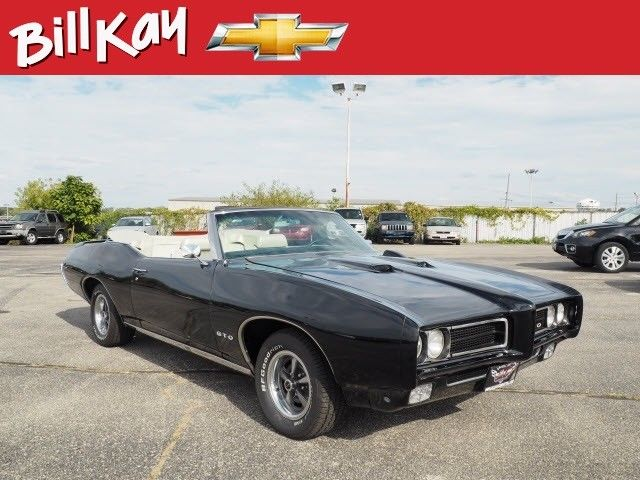 1969 Black Pontiac GTO Coupe with Cream interior