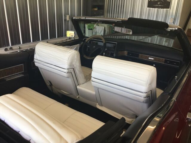 1970 Burgundy Cadillac DeVille Convertible with White and black interior