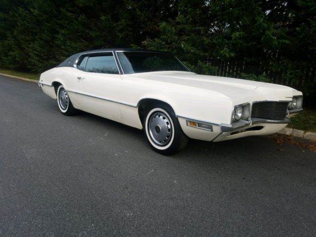 1970 white Ford Thunderbird fastback with blue interior