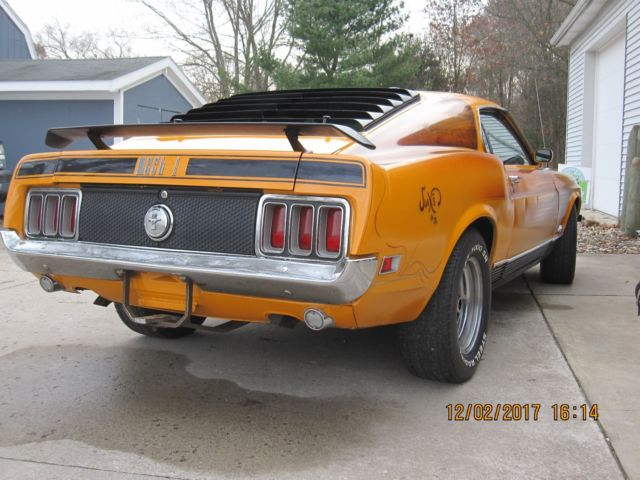 1970 Orange Ford Mustang mach-1 Fastback with Black interior