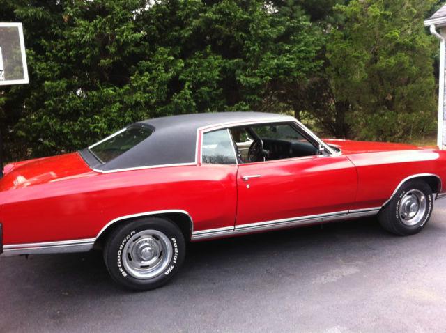 1970 monte carlo red in color with original rebuilt
