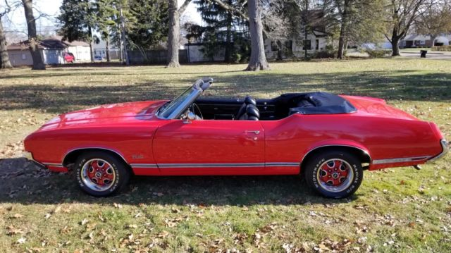 1971 Red Oldsmobile Cutlass Convertible with Black interior